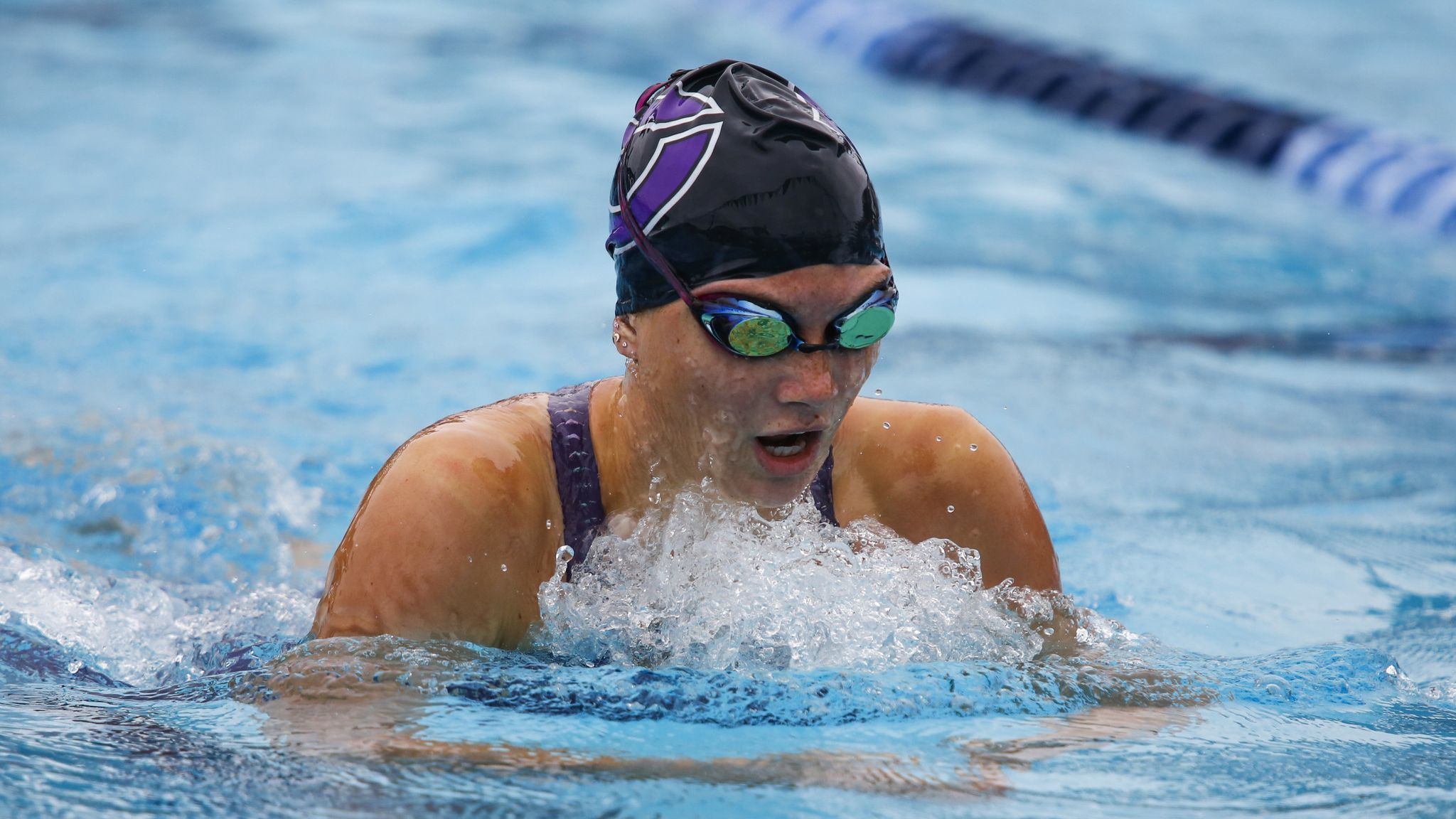 Carlsbad's Anna Brooker swims the breaststroke in the 200 yard individual medley final.