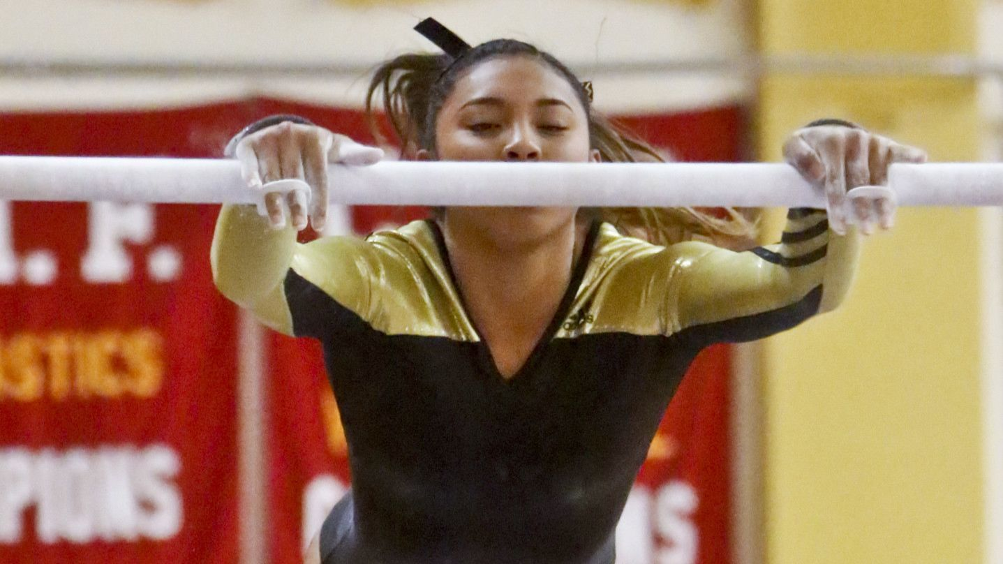 Westview's Cadean Milan performed her routine on the uneven bars during the gymnastics meet at Mt. C
