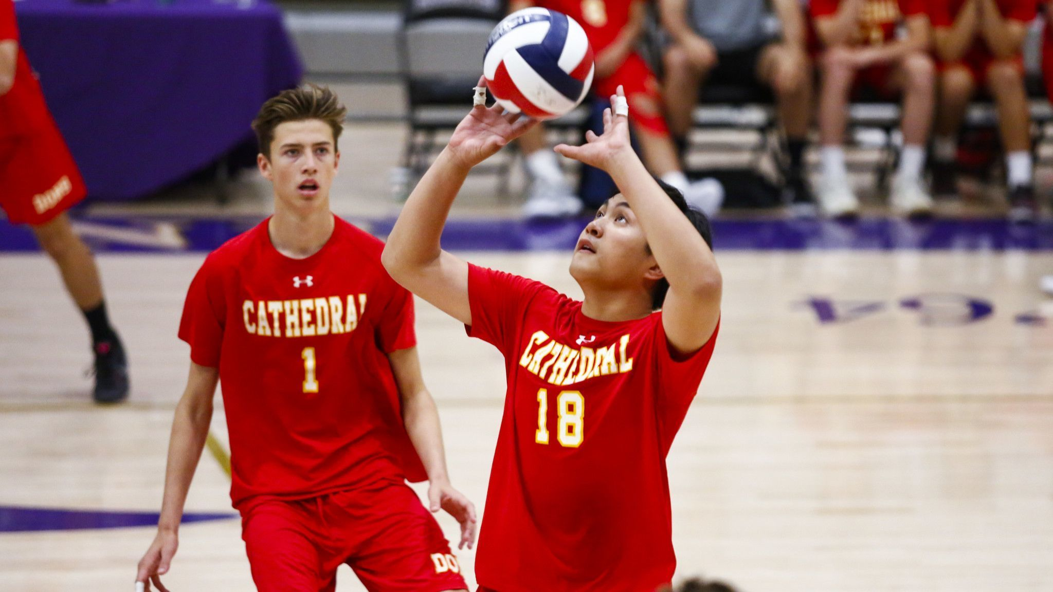 Cathedral's Kris Pua sets up a shot during the third set against Eastlake.