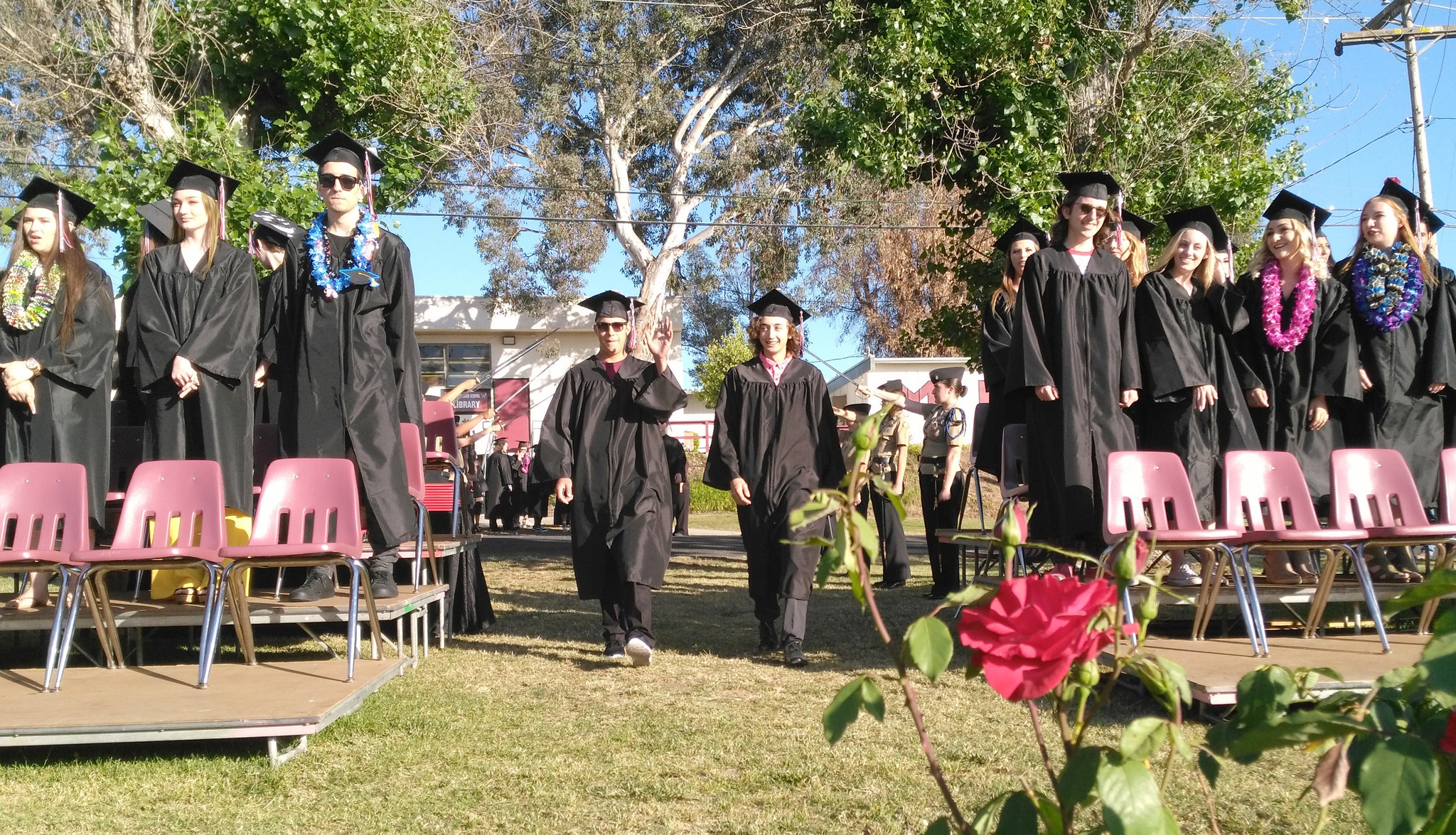Zachery Okesson, left, and Trevor Keck walk the aisle during the Montecito High School graduation ceremony. Keck completed his high school education in three years.