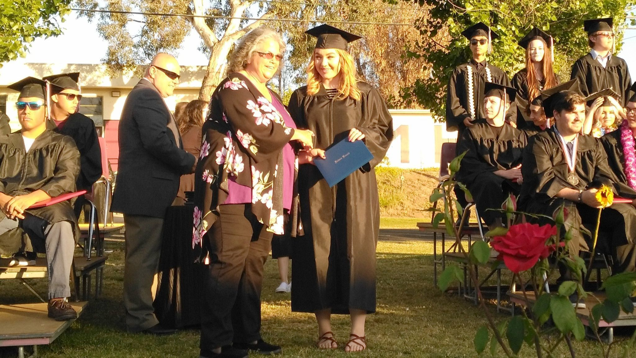 Ramona Unified School District Trustee Kim Lasley presents a diploma to Kailey Hall, a Future Bound Independent Study Program graduate.