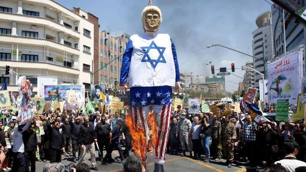 In 'Jerusalem Day' protest, Iranians burn effigy of President Trump dressed in an Israeli flag