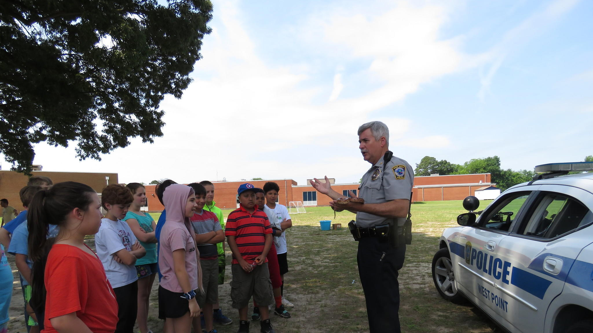 Police officer talking with students