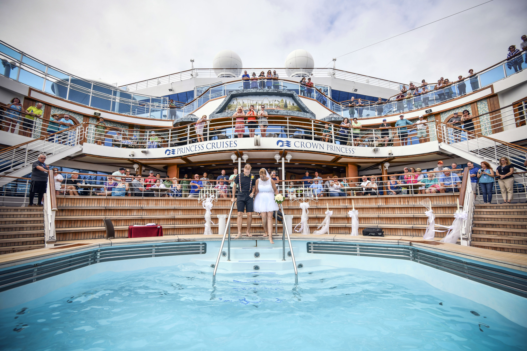 Bride Tami Van Dusen is escorted into a pool aboard the Crown Princess to wed Tim Ashley.
