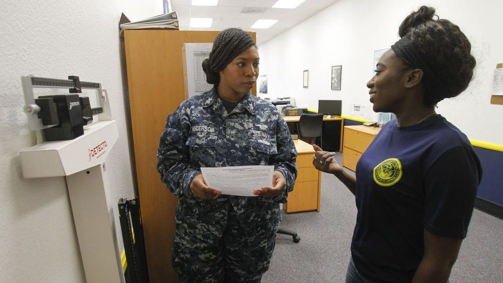 ESCONDIDO, May 24, 2018 | Mission Hills senior Racheal Gibson talks to Navy recruiter Petty Officer