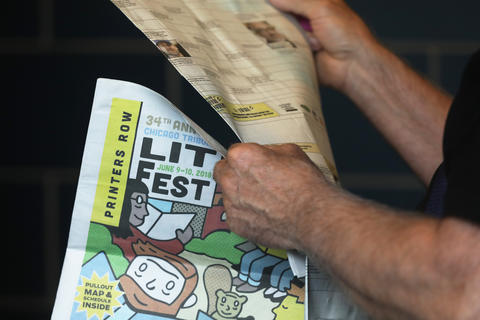 A fest-goer looks at the schedule for the Printers Row Lit Fest on June 9, 2018, in Chicago.