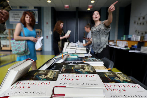 Vendors sell books inside Jones College Prep High School during the Printers Row Lit Fest on June 9, 2018, in Chicago.
