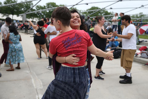 Annika Rolo dances with Margaret Griffeth during the Chicago Blues Festival at the Jay Pritzker Pavilion in Chicago on June 10, 2018.