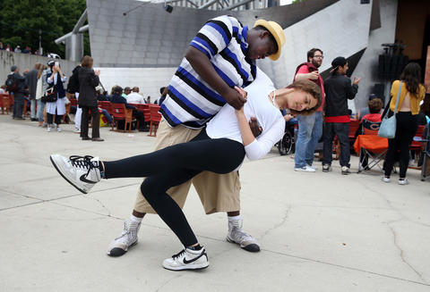 Magdelena Allen dances with Sikiru Ogundimu during the Chicago Blues Festival at the Jay Pritzker Pavilion in Chicago on June 10, 2018.