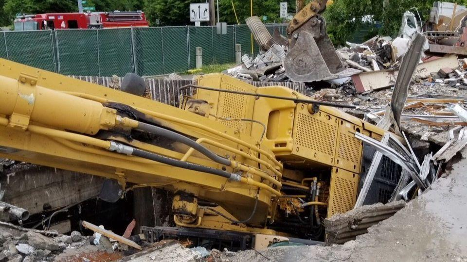 Manchester Fire Department: Excavator Falls Into Basement During Demolition    Hartford Courant