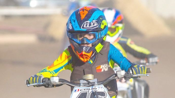 Colin Petton, 10, shares an enthusiasm for motorcycle racing with his older brother Travis.