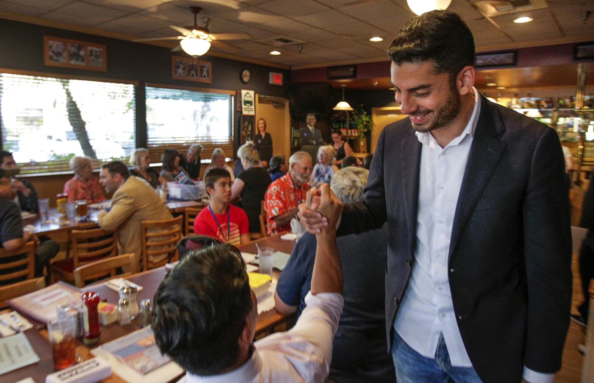 SANTEE, August 17, 2017 | Ammar Campa-Najjar, 28, a candidate for 50th congressional district, shake