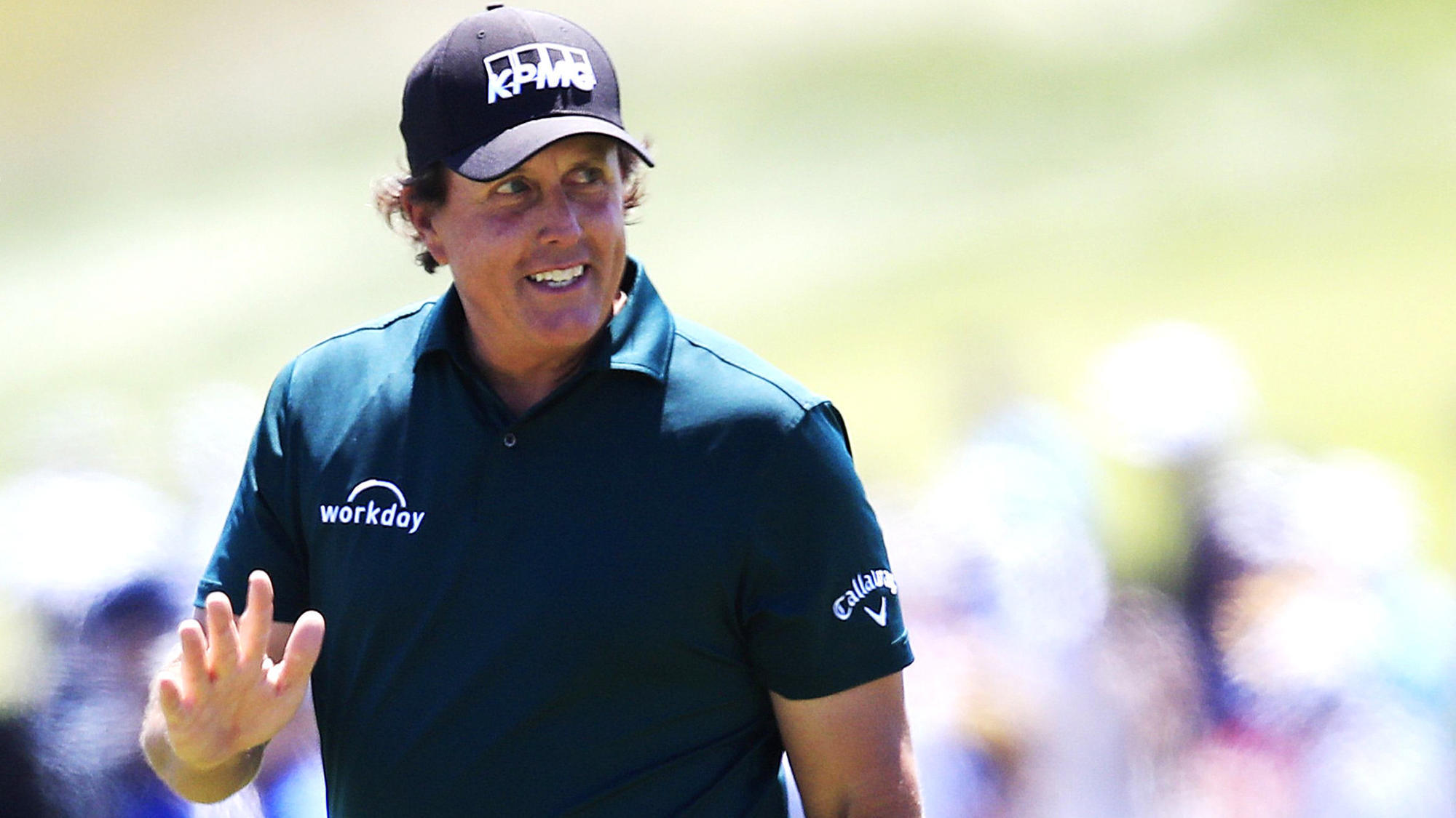 Phil Mickelson takes two-shot penalty for hitting a moving ball rather than chasing it down a slope