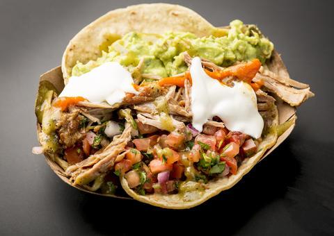 Carnitas tacos at Dos Toros insideWells St. Market.