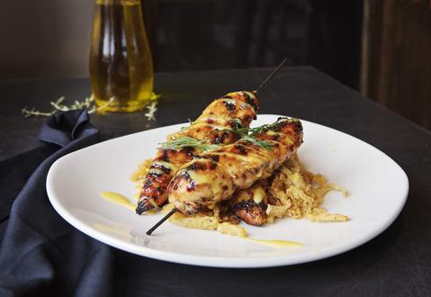 Grilled chicken honey dijon skewer on the Weber Grill Summer Happy Hour Specials.