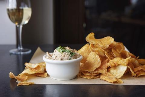 Kettle chips and smoked onion dip on the Weber Grill Summer Happy Hour menu.