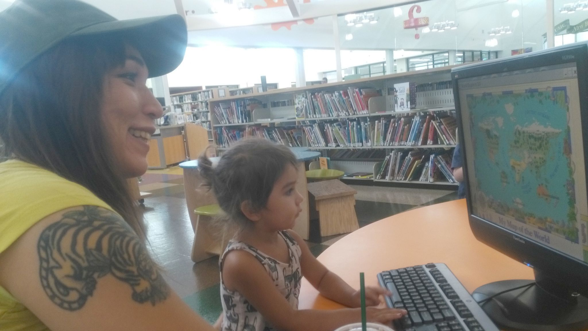 Nicole Beltran and daughter Penny cool down at the Ramona Library on July 6. Nicole enjoyed a refreshing iced coffee while Penny had one of the library's free summer lunches.