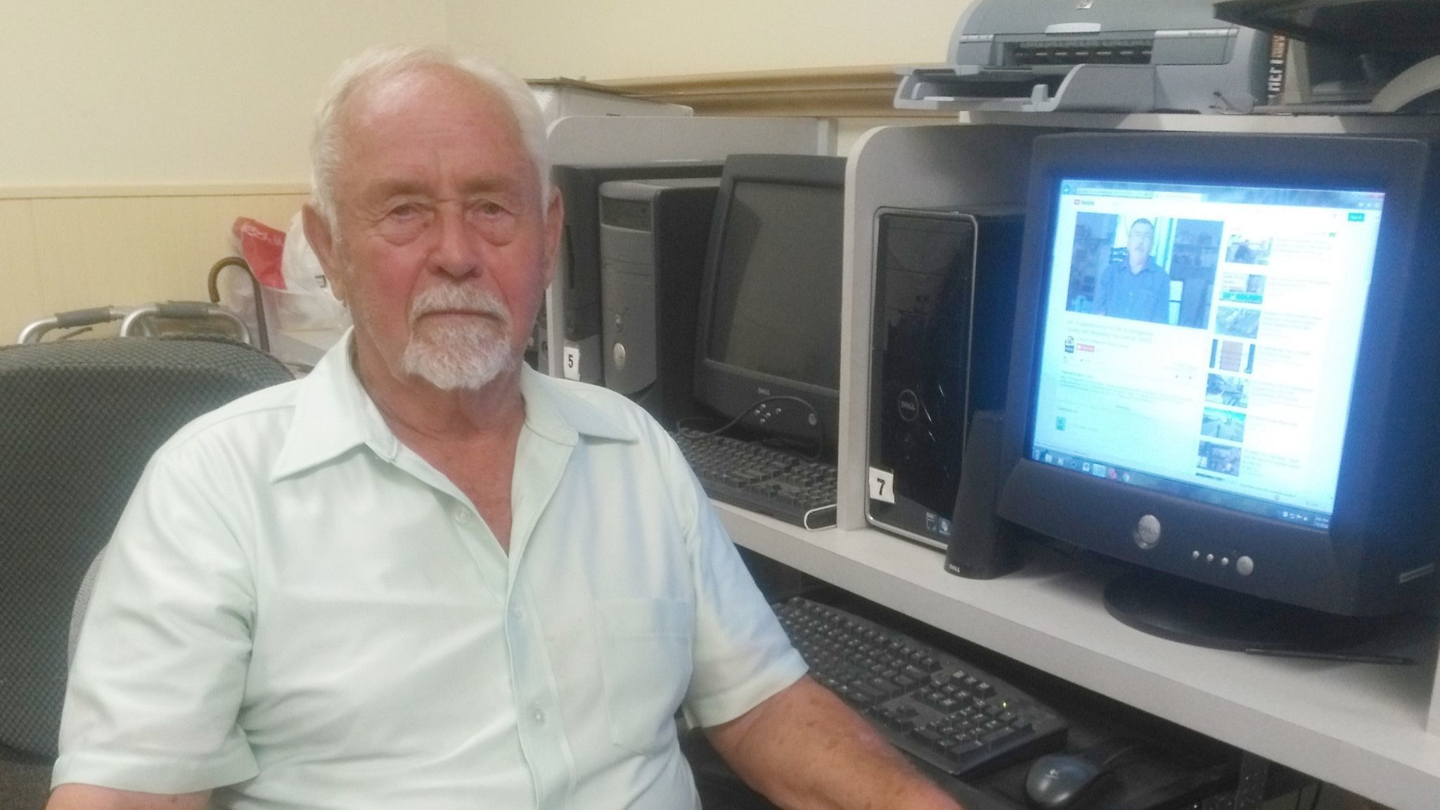Glen Anderson cools off while working at a computer in the Ramona Senior Center on July 6.