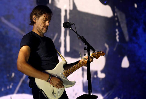 Guitarist Ed O'Brien performs with Radiohead at the United Center in Chicago on July 6, 2018.