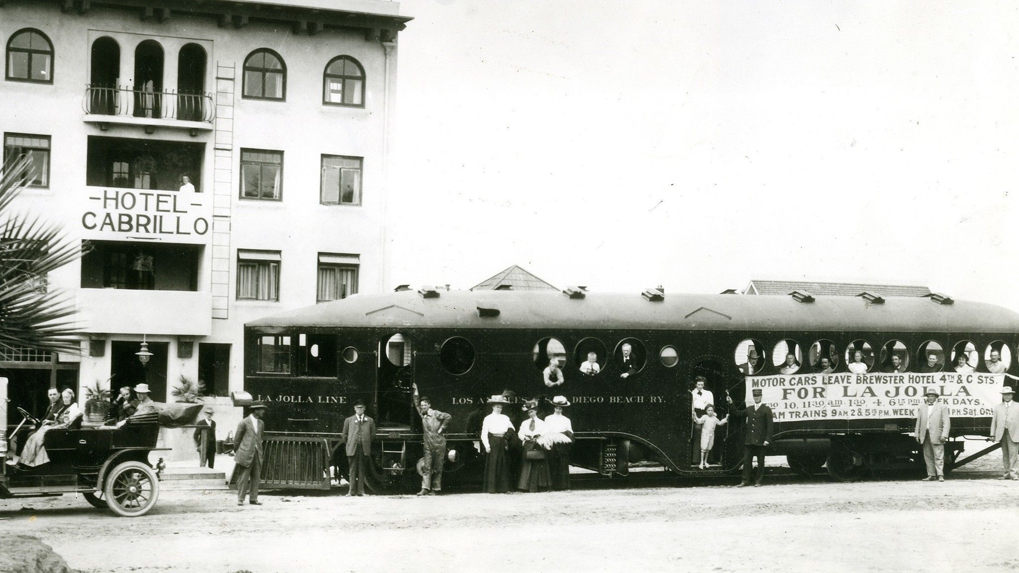 "In a photo circa 1912-1916, the Los Angeles & San Diego Beach Railroad's ""Red Devil,"" a gas-powered McKeen motorcar, parks in front of the Cabrillo Hotel (incorporated into La Va"
