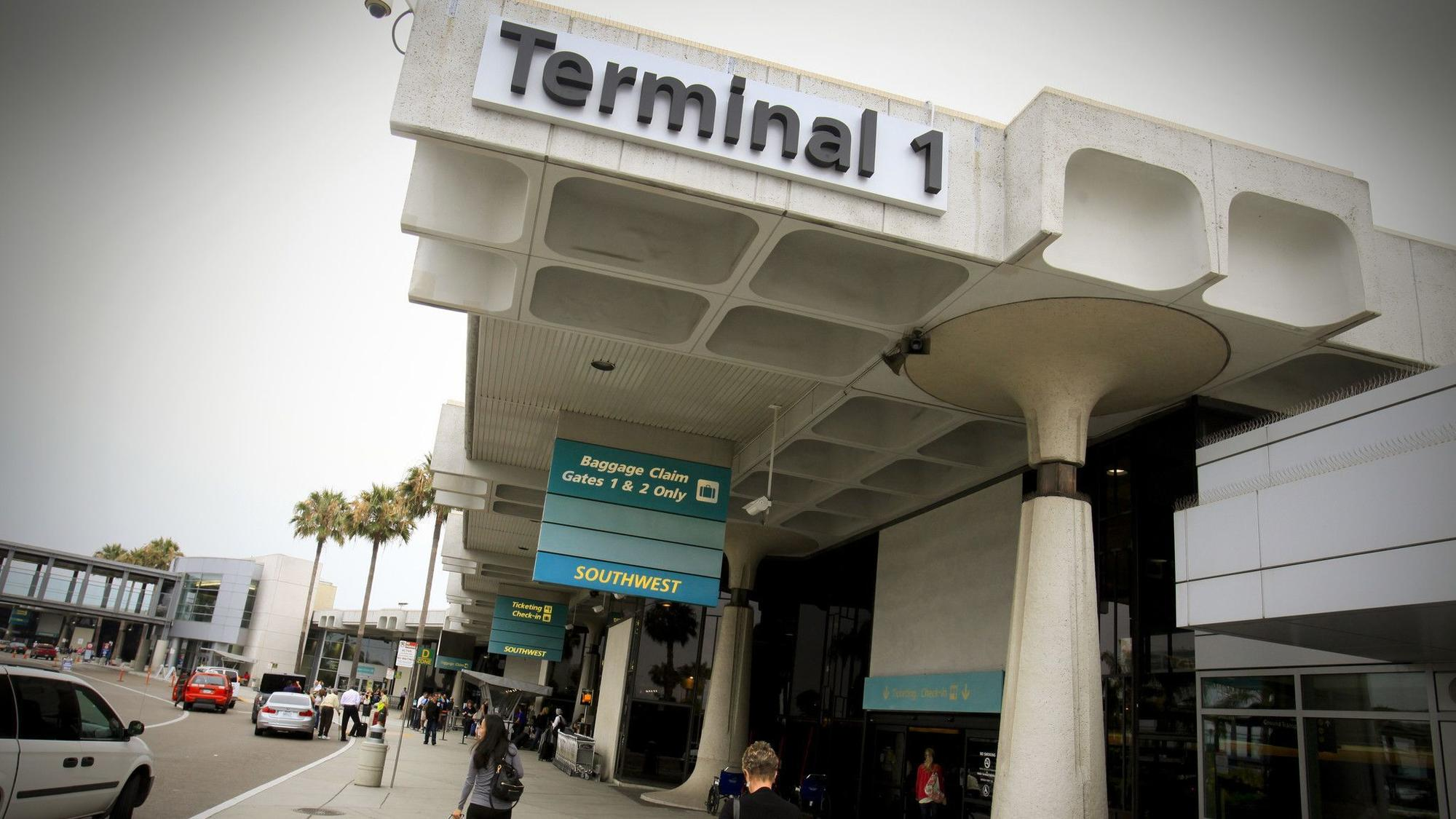 Passengers head for Terminal 1 at San Diego International Airport Lindbergh Field.