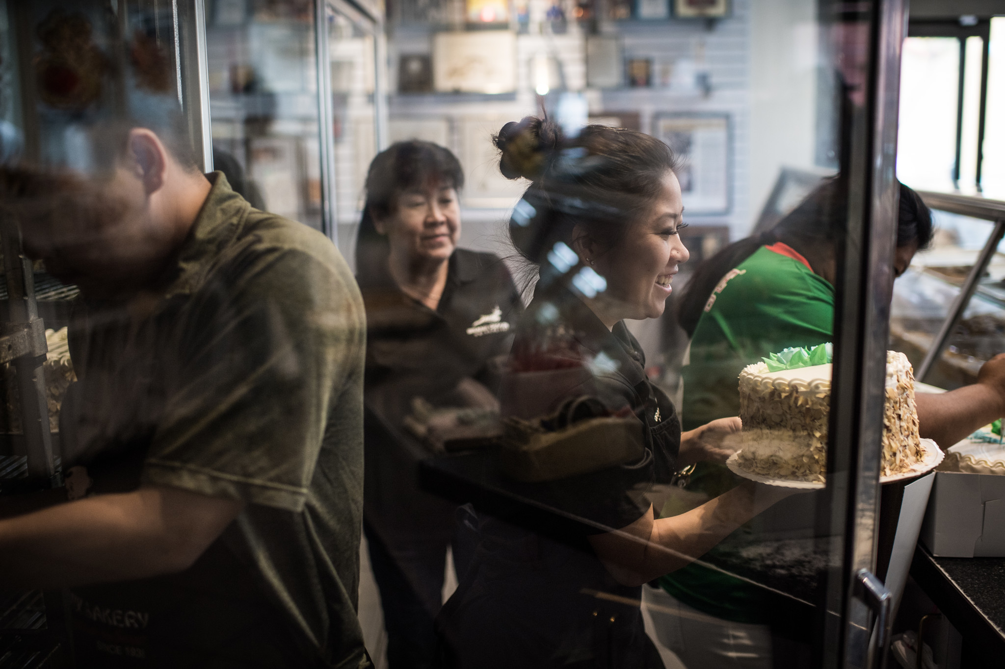 LOS ANGELES, CA - June 17, 2018 Melissa Chan serves a customer at Phoenix Bakery in Chinatown, a fa