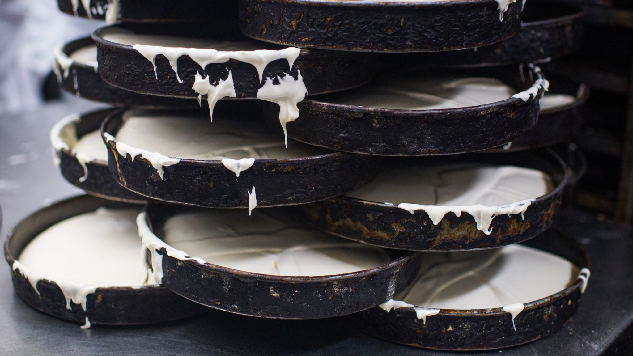LOS ANGELES, CA - June 13, 2018 Cake batter waits in molds to be cooked in the industrial oven at P