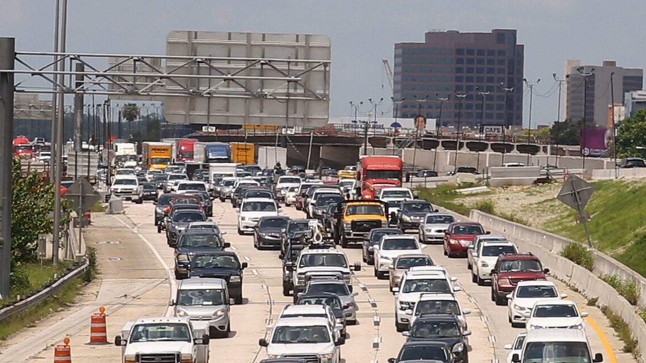 Motorist travel at a crawl Tuesday, July 10, 2018 in westbound lanes of Interstate 4 in downtown Orl