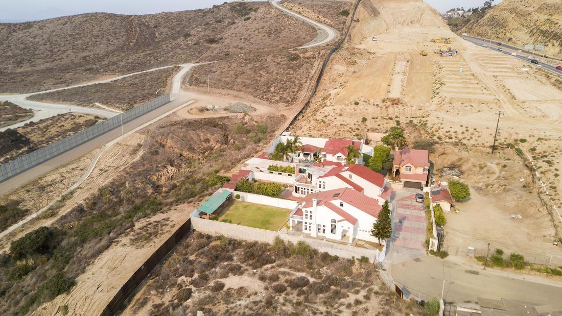 Border fence houses