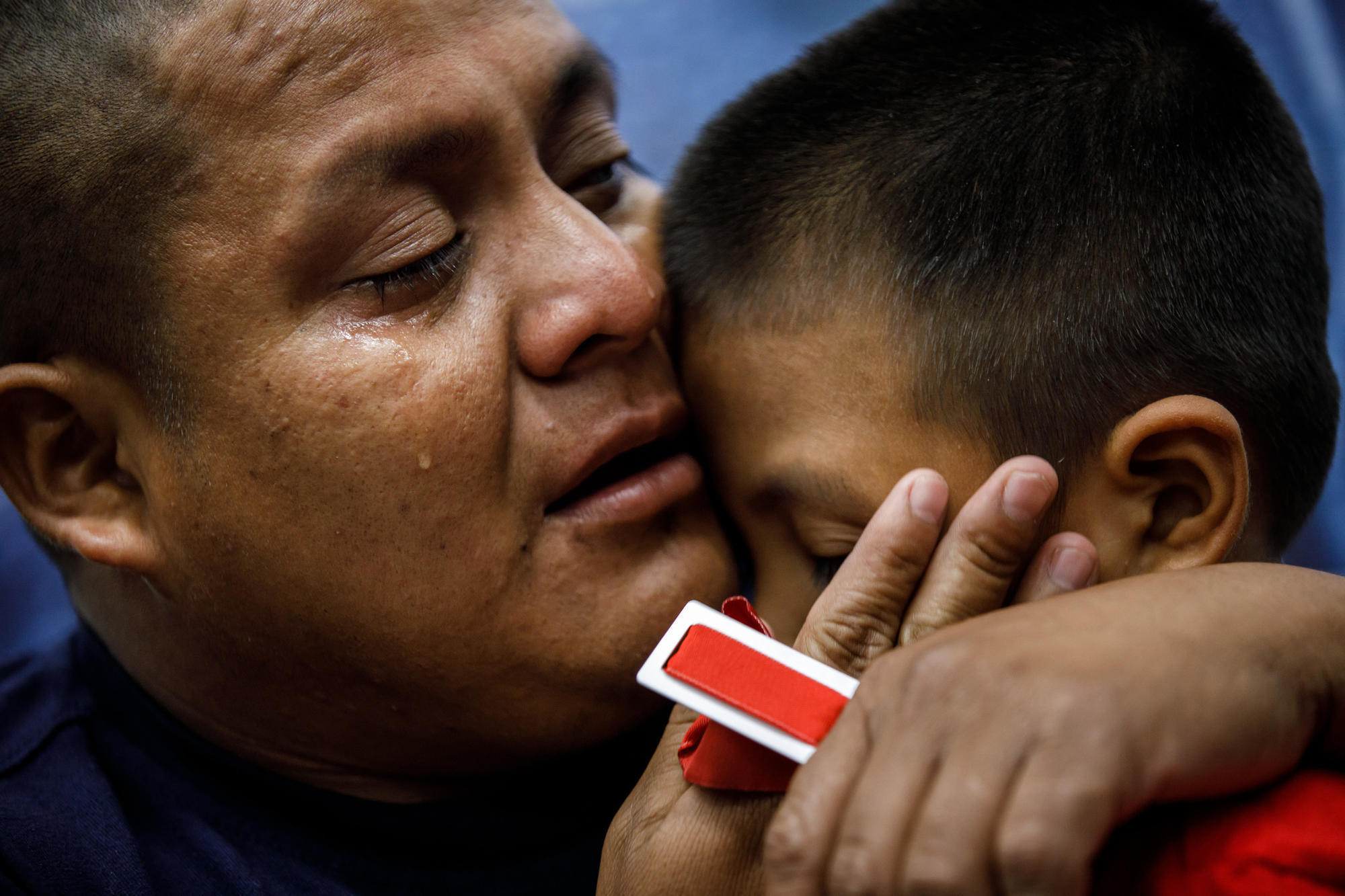 'I'm here. I'm here.' Father reunited with son amid tears, relief and fear of what's next