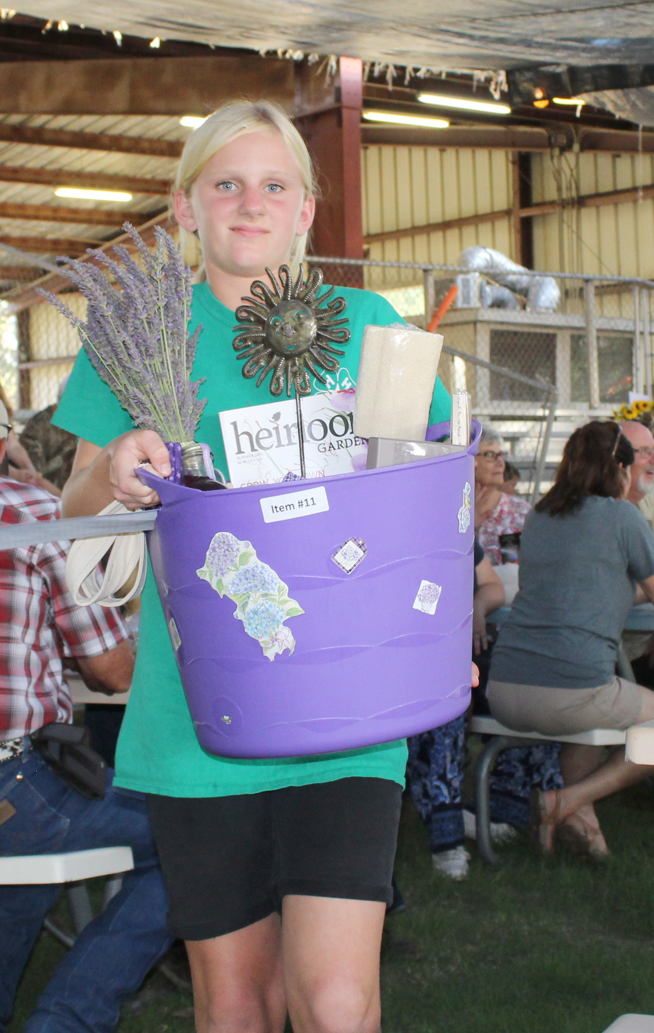 Ramona Stars 4-H'er Kiara Konyn shows the Lavender Basket prepared by Ramona Stars-4-H. The high bid of $590 came from Sheila and Rich Swafford.