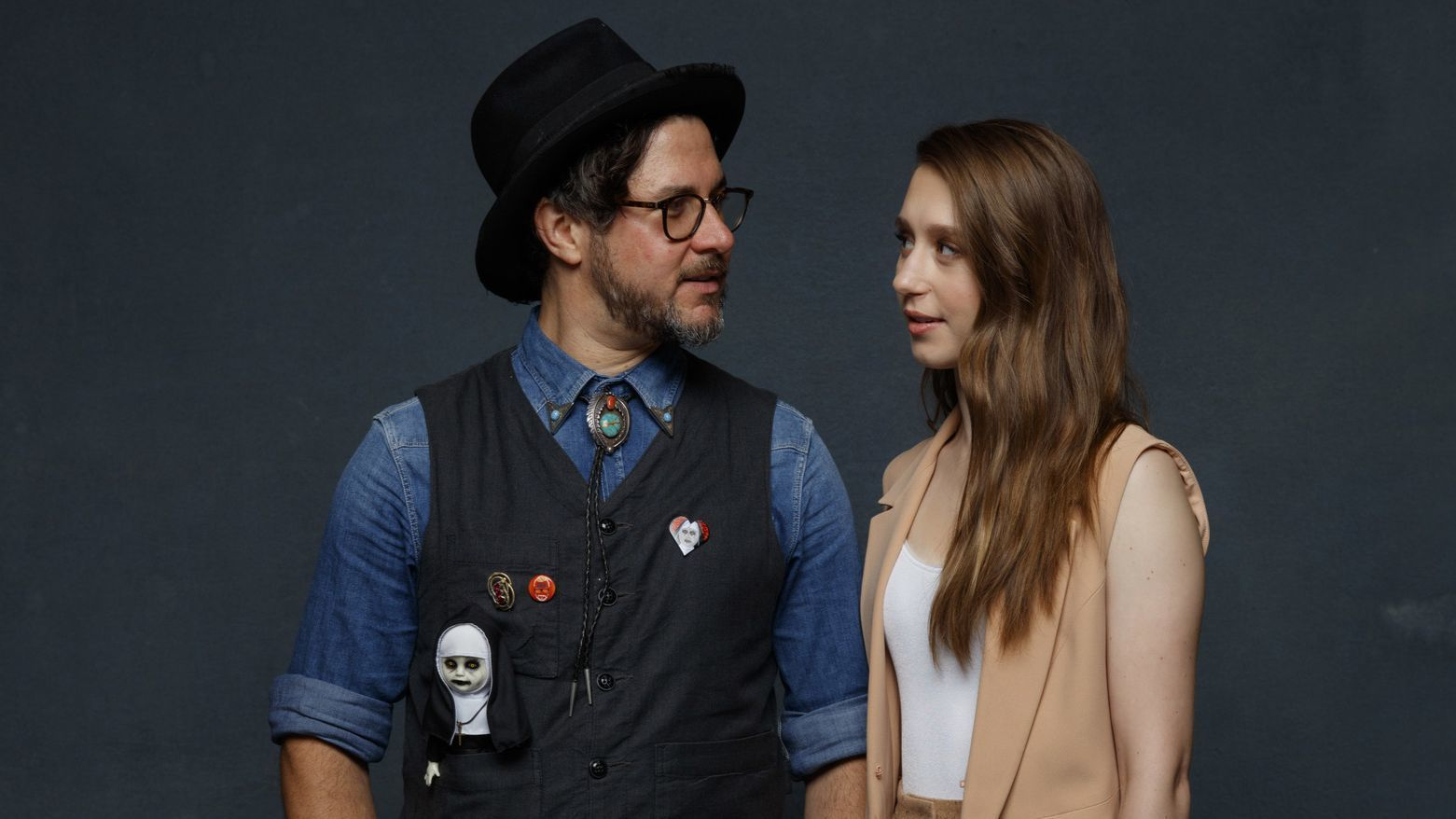 "Director Corin Hardy and Taissa Farmiga from the film ""The Nun."""