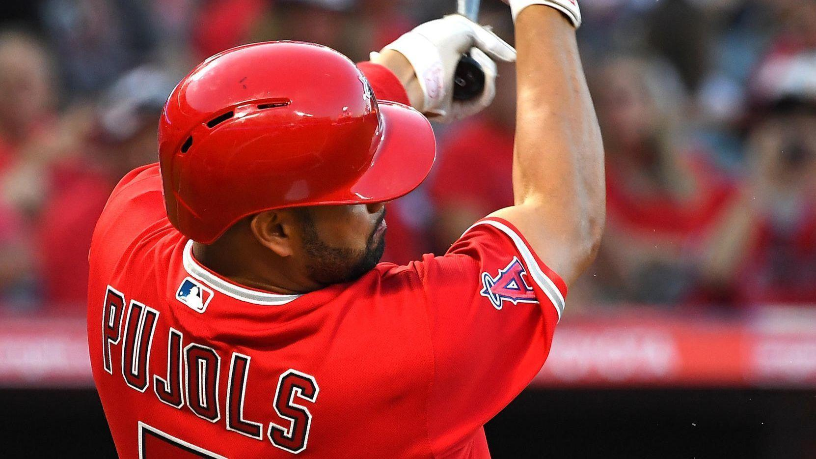 Angels' Pujols continues to play at 'high level' despite knee issues