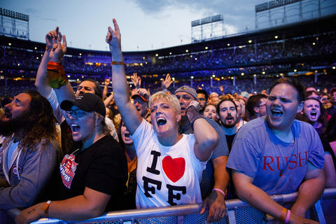 Audience members watch the Foo Fighters perform at Wrigley Field, July 29, 2018, in Chicago.
