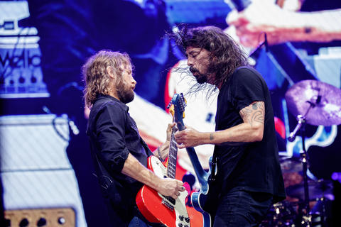 Dave Grohl, right, and Chris Shiflett perform with members of the Foo Fighters at Wrigley Field, July 29, 2018, in Chicago.
