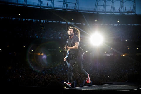 Dave Grohl performs with members of the Foo Fighters at Wrigley Field Sunday, July 29, 2018, in Chicago.