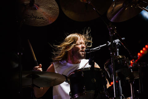 Taylor Hawkins performs with members of the Foo Fighters at Wrigley Field, July 29, 2018, in Chicago.