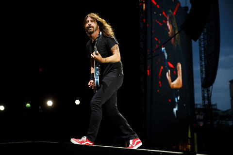 Dave Grohl performs with members of the Foo Fighters at Wrigley Field, July 29, 2018, in Chicago.