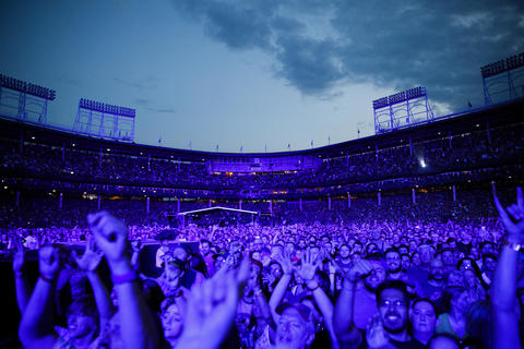 Members of the audience watch the Foo Fighters perform at Wrigley Field, July 29, 2018, in Chicago.