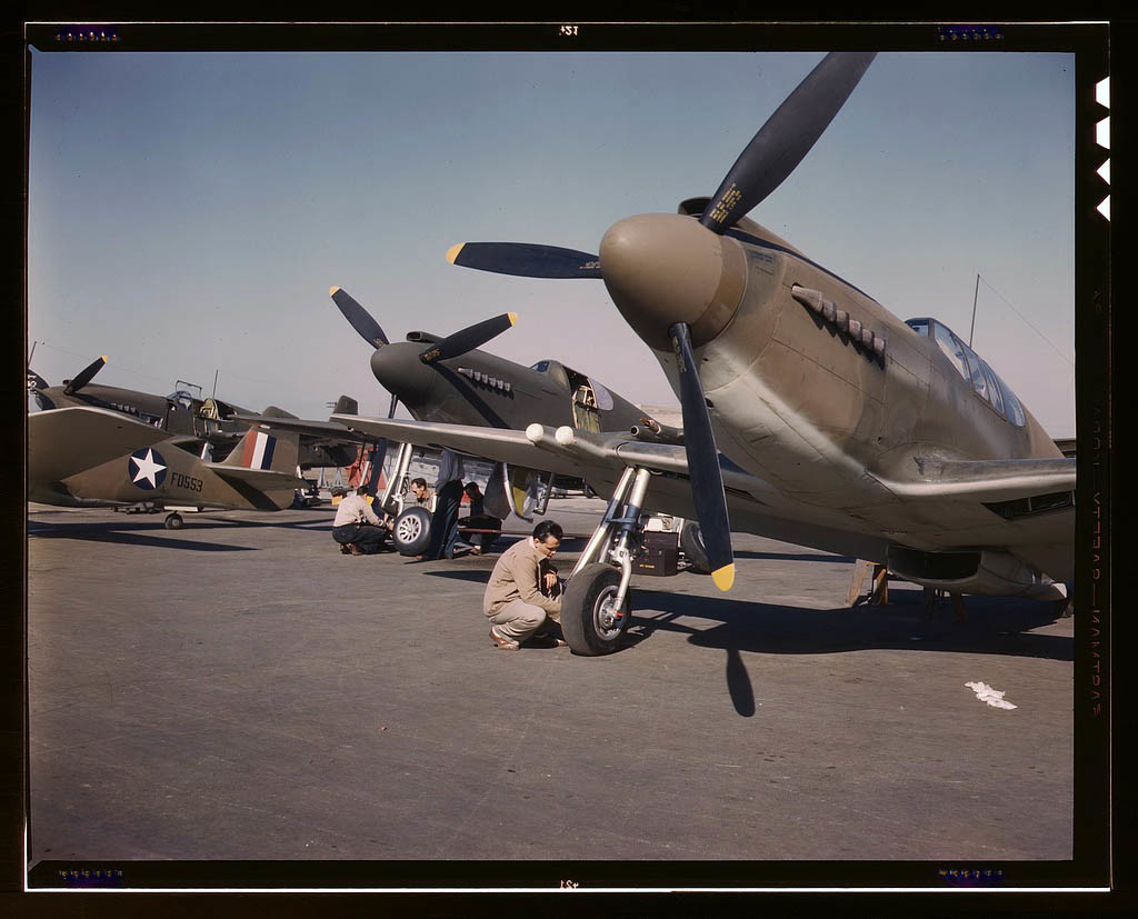 """P-51 (""""Mustang"""") fighter planes being prepared for test flight at the field of the North American Av"""