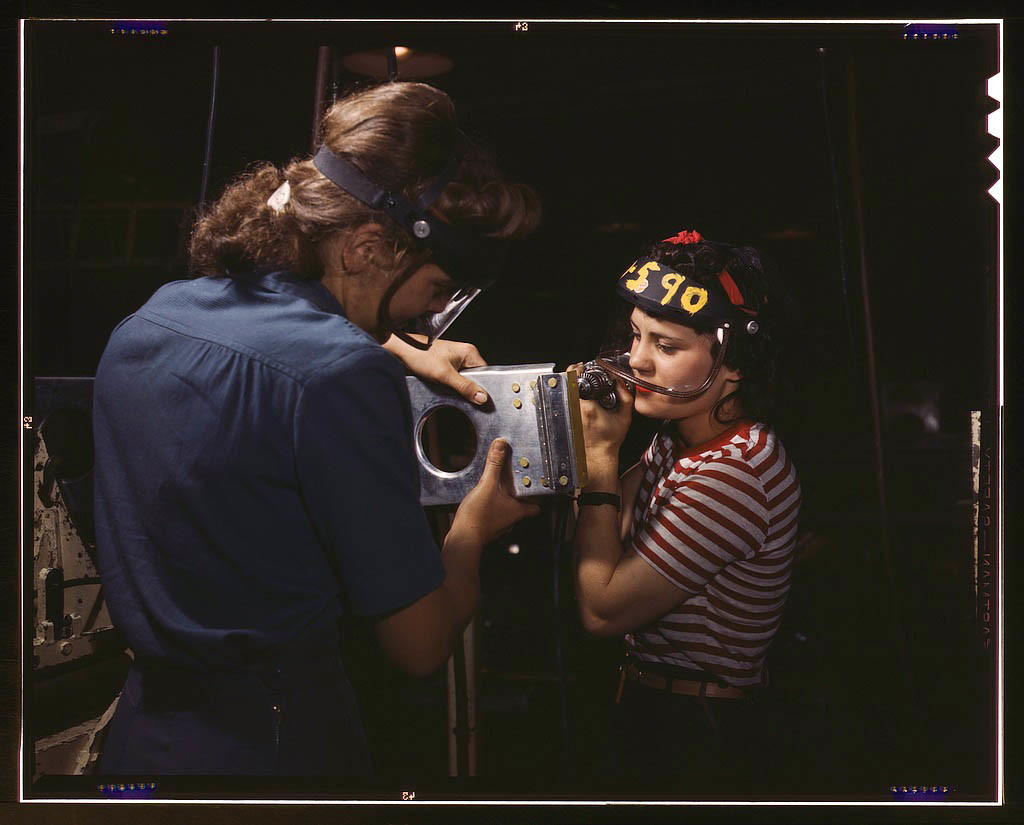 Two female employees of North American Aviation, Incorporated, assembling a section of a wing for a P