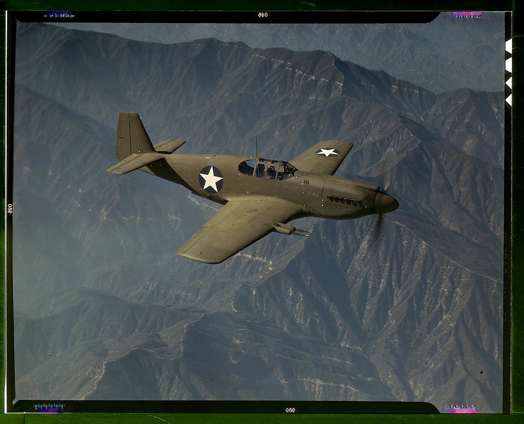 """P-51 """"Mustang"""" fighter in flight over Southern California. Built by North American Aviation in, Ingl"""