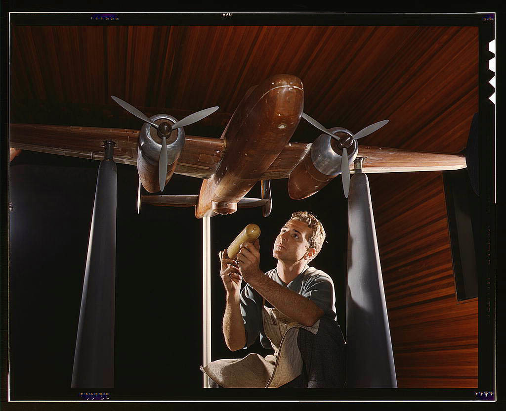 An experimental scale model of the B-25 plane is prepared for wind tunnel tests in the plant of the