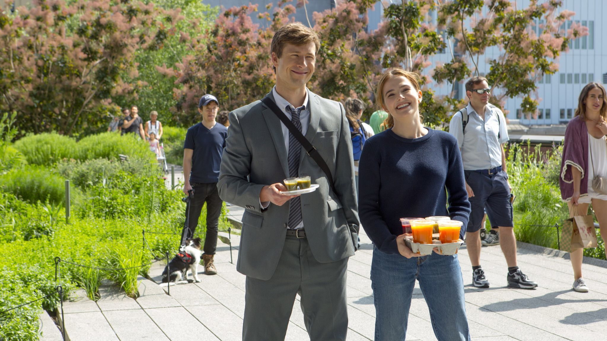 "Glen Powell and Zoey Deutch in a scene from ""Set It Up."""