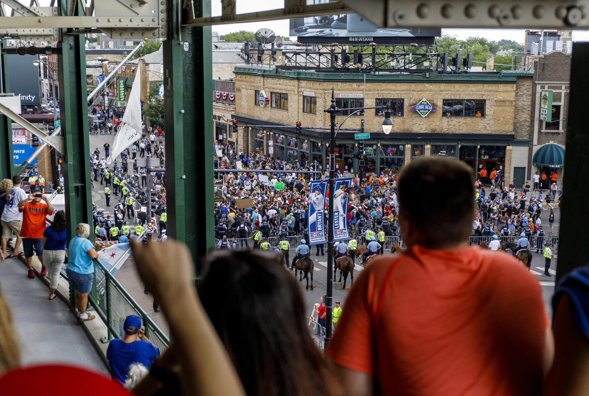 Protesters pray, chant outside Wrigley after anti-violence march briefly shuts down Lake Shore Drive