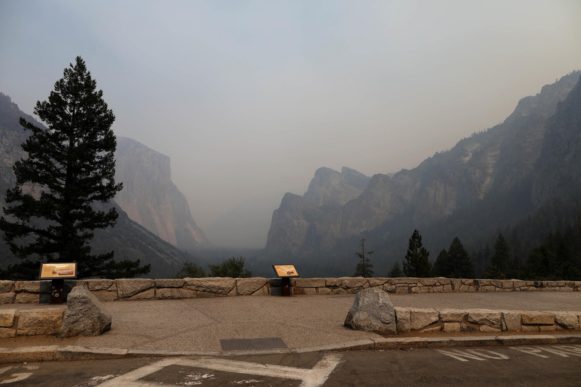 Fire siege leaves Yosemite empty of humans, filled with smoke during peak summer season