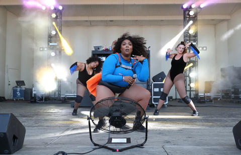 Lizzo, center, performs at Lollapaloozaon Aug. 3, 2018, in Chicago.