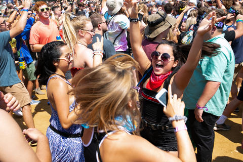 Paulina Mendez of Toledo, Ohio, dances as Goldfish performs at Perry's stage at Lollapalooza on Aug. 3, 2018.