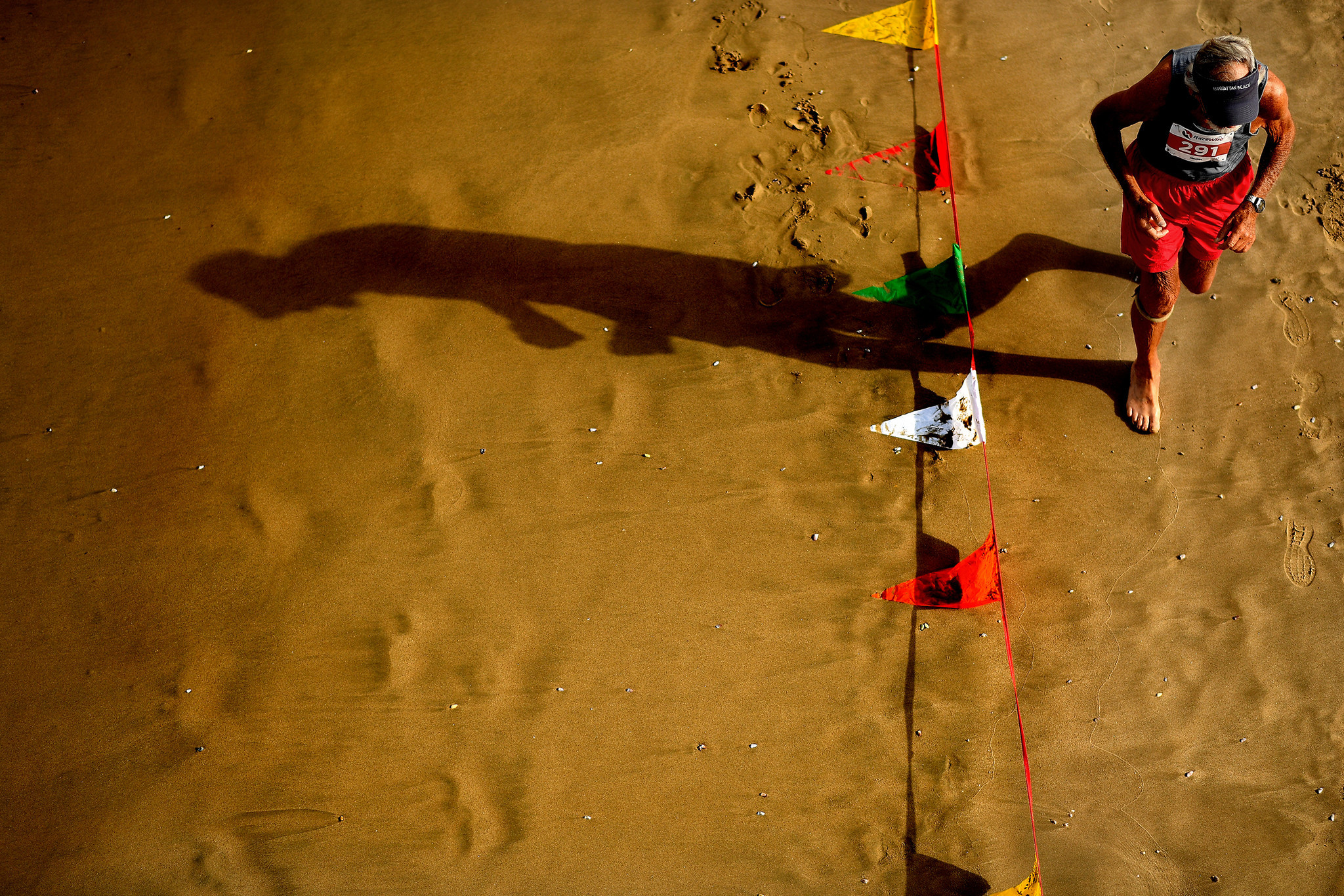 HERMOSA BEACH, CALIFORNIA AUGUST 4, 2018-A runner competes in the Dick Fitzgerald beach run during t