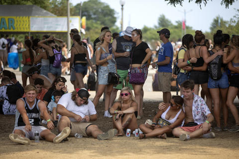 People sit in the shade on a hot day at Lollapalooza on Aug. 5, 2018, at Grant Park in Chicago.